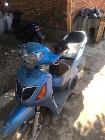 Продам Honda SH