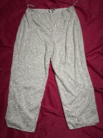 Cekinowe biale spodnie firmy asos 42 świecące