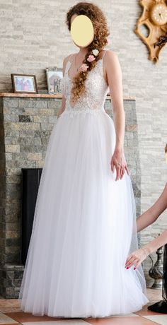 Suknia ślubna z pięknie wyeksponowanymi plecami
