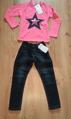 Różowa bluzka dziewczęca i jeansy 110