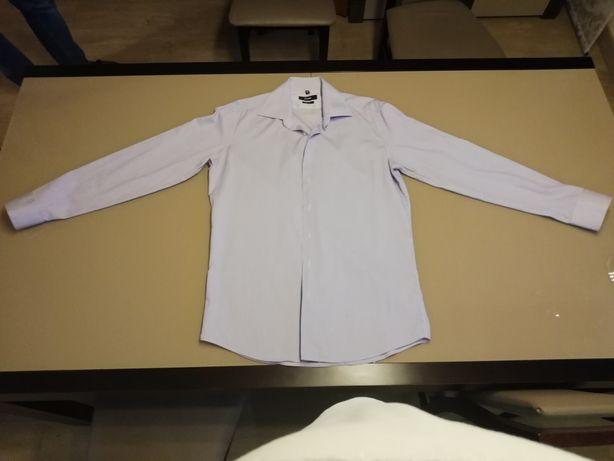 Sprzedam fioletową koszulę w prążki marki Próchnik. Rozmiar 42/L.