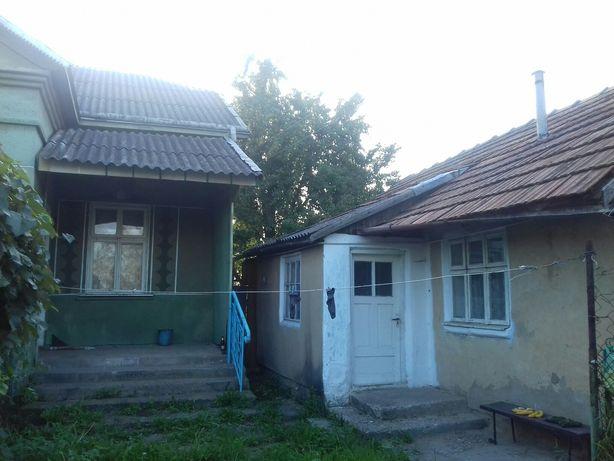 Будинок зі земельним участком