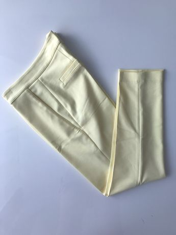 Nowe spodnie na kant cygaretki żółte S 36
