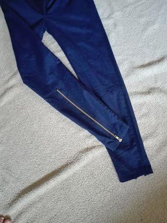 Spodnie materiałowe rozpinane nogawki 36