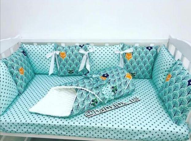 Набір бортиків ( подушечок) в дитяче ліжечко