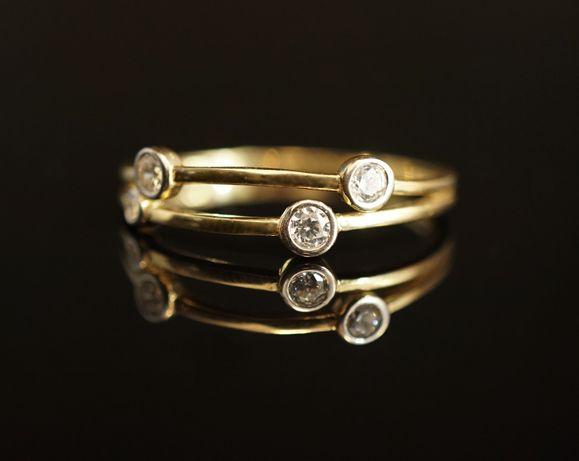 Złoto 585 - złoty pierścionek z cyrkoniami. Rozmiar 22