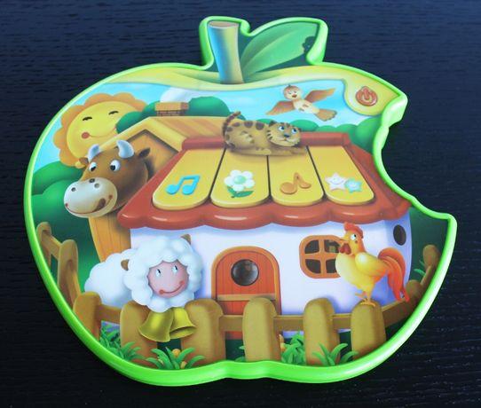 Brinquedo musical em forma de maça (COMO NOVA)