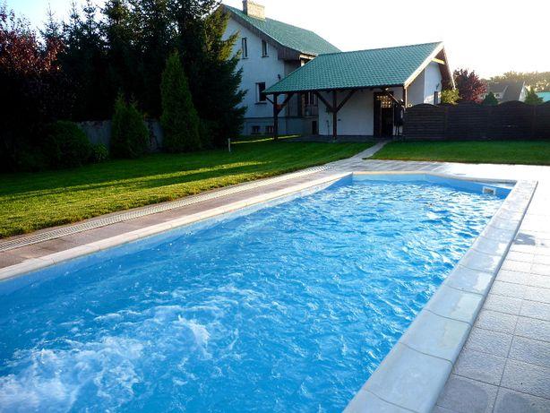 Dom nad jeziorem z krytym basenem - bezpośrednio