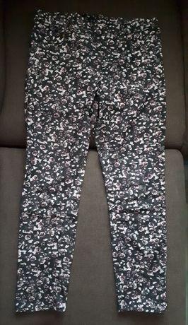 H&M (40) dopasowane spodnie jeansy w gumkę, jegginsy w kwiaty