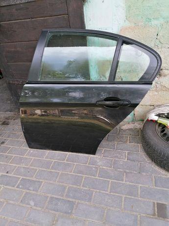 Drzwi lewe tył tylne bmw e90 sedan black sapphire