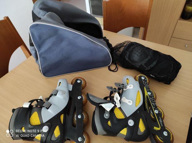 Vendo patins com proteções e bolsa de transporte