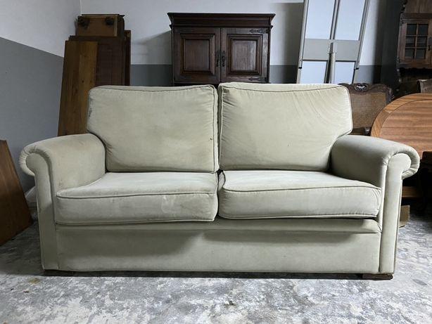Sofá de tecido cinzento