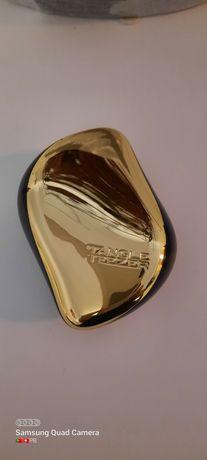 Tangle Tezzer nunca usado