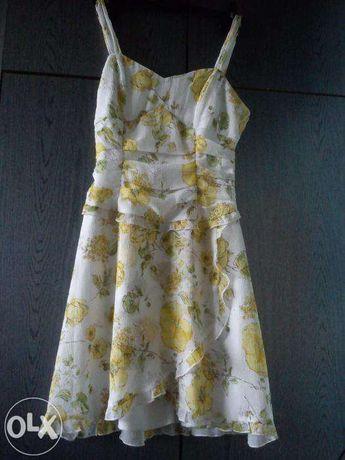 Letnia gorsetowa sukienka baskinka w żółte kwiaty Ruby Rox