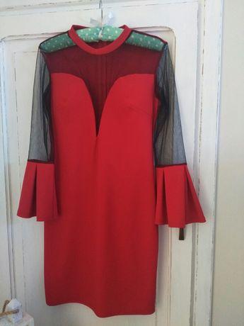 Suknia XS widoczna na zdjęciu.