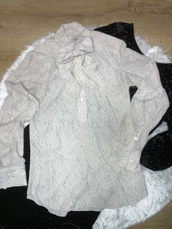 Блуза молочного кольору