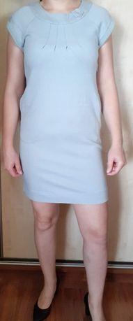 Sukienka dzianinowa z kieszeniami 38