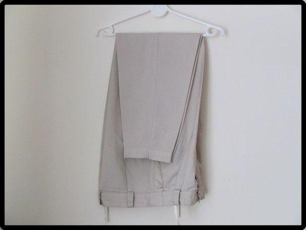 Jasno beżowe spodnie na kant rozmiar L