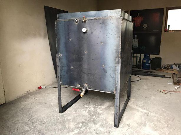 Topnik do parafiny nowy z olejem transformatorowym.
