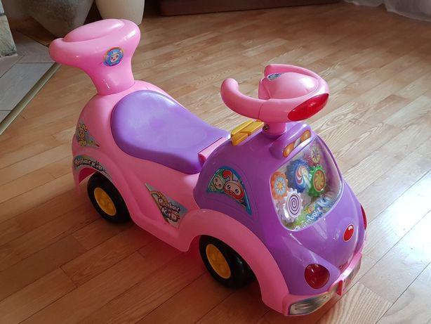 Grający samochodzik - jeździk- pchacz
