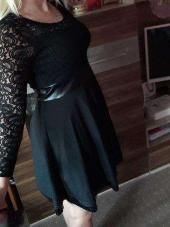 Czarna sukienka na wesele koronkowa rozkloszowana M L