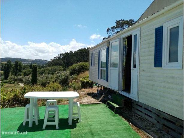 Terreno Urbano perto da praia da calada com casa móbil T2