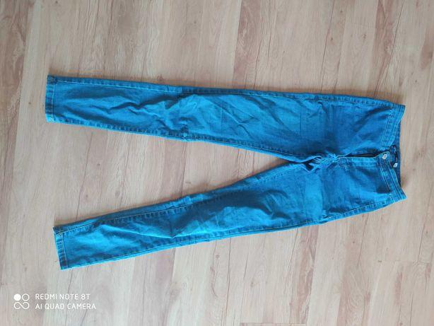 Spodnie rozm 34