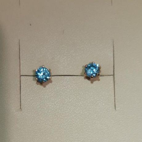 Сережки гвоздики пусеты золотые 585 с голубыми топазами