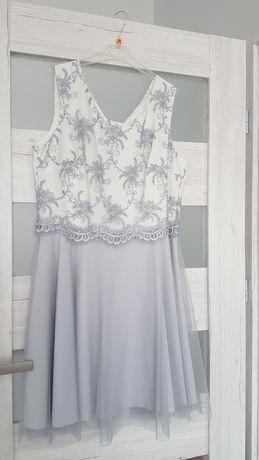 Sprzedam śliczną nową sukienkę.