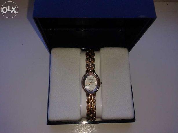часы позолоченные фирмы Romanson.