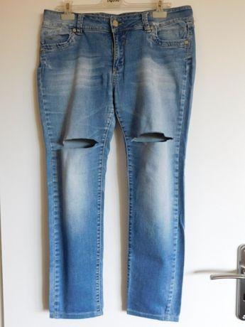 "Oddam za darmo damskie jeansy z rozcięciami ""Monella Vagabonda"" r. L"