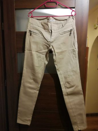 Kremowe dlugie spodnie