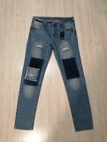 Spodnie jeansowe z przetarciami Esmara rozmiar 38