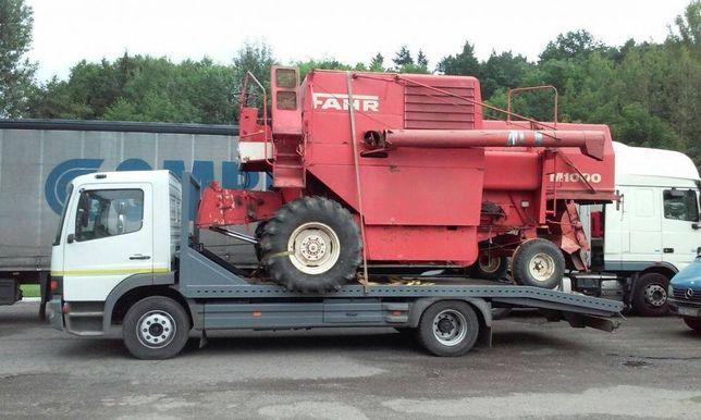 Transport maszyn rolniczych budowlanych autolaweta laweta