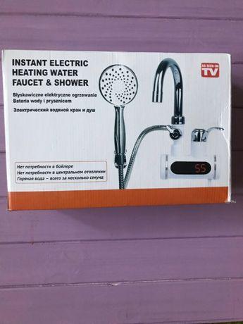 Продам электрический водяной кран и душ