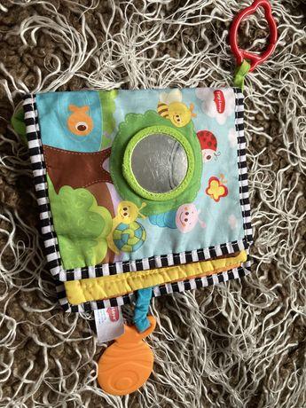 Książka  Tiny Love sensoryczna zawieszka gryzak piszczałka lusterko