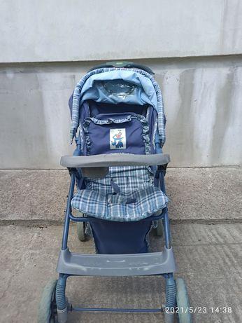 Синя коляска дитяча