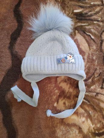 Продам зимнюю шапку на ребенка