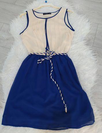 Sukienka damska rozmiar S marki Atmosphere kremowo niebieska bez rękaw