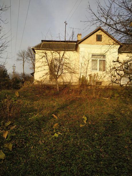 продаж двокімнатної квартири з земельною ділянкою