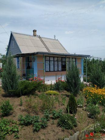 Продается дачный участок с домом у водоема в 30 км от Мариуполя