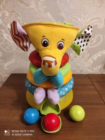 Музывальная игрушка слоник - пирамидка Tiny love