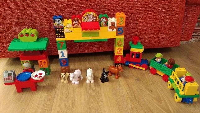 Lego Duplo stragan, ciuchcia, wywrotka, policja, traktor bob, figurki