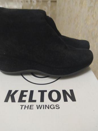 Продам зимние сапоги,фирма Kelton
