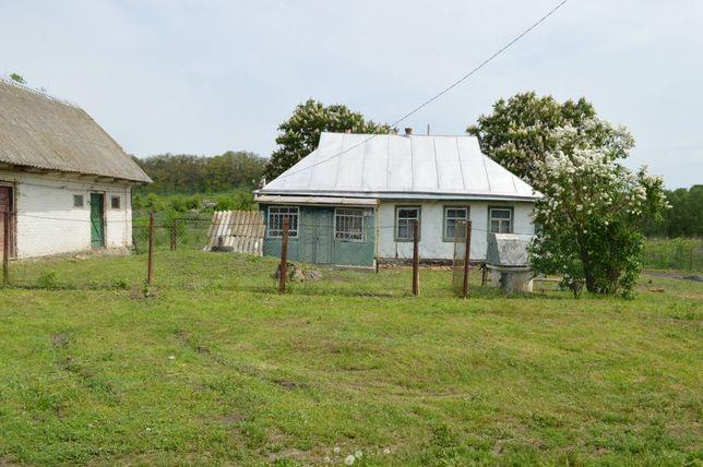 Земельна ділянка з будинком
