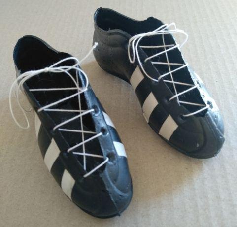 Par de botas de futebol miniatura