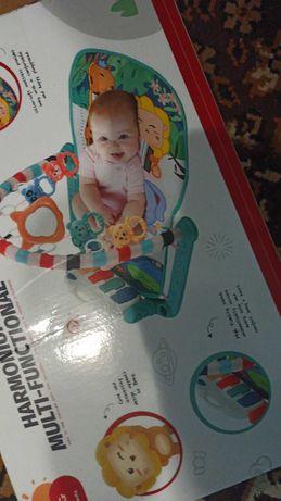 Детский шезлонг с игрушками