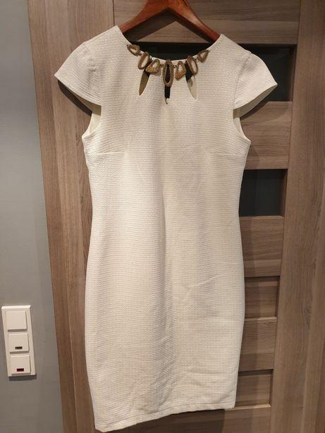 Sukienka kremowa z drobinkami zlotej nitki
