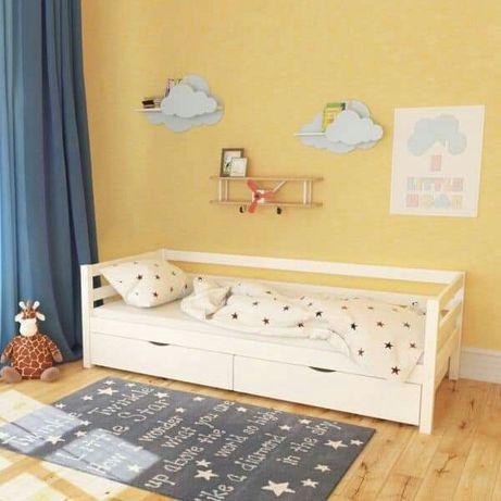 Дитяче дерев'яне ліжко