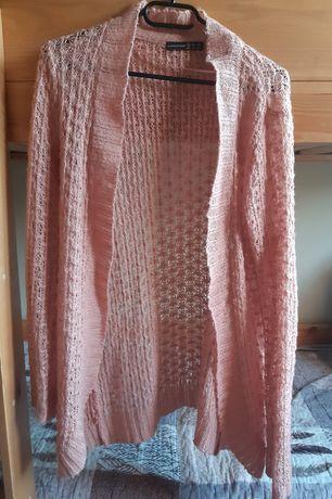 Rózowy sweterek.